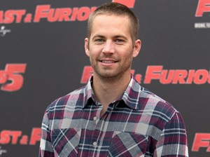 """FILE - In this April 29, 2011 file photo, actor Paul Walker poses during the photo call of the movie """"Fast and Furious 5,"""" in Rome. Walker's brothers are filling in to help finish shooting on """"Fast & Furious 7."""" Universal Pictures announced Tuesday, April 15, 2014, that Caleb and Cody Walker are filling in for their late brother to complete some remaining filming. Production has resumed on """"Fast & Furious 7"""" after it was suspended following Walker's death in late November. (AP Photo/Andrew Medichini, File)"""