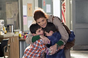"In this photo provided by NBC, Debra Messing, top, portrays Laura Diamond in the new NBC series, ""The Mysteries of Laura."" Also pictured are Charlie Reina, as Harrison Diamond, left, and Vincent Reina as Nicholas Diamond. (AP Photo/NBC, KC Bailey)"