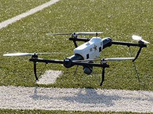 FILE - In this May 14, 2013 file photo, one of several small drones designed for use by law enforcement and first responders is shown at University of North Dakota in Grand Forks, N.D. Thirteen leading news organizations are challenging the Federal Aviation Administration's ban on journalists' use of drones, saying it violates First Amendment protection for news gathering. The organizations, including The Associated Press, filed a brief with the National Transportation Safety Board Tuesday, May 6 in support of aerial photographer Raphael Pirker. (AP Photo/Minnesota Public Radio, Dan Gunderson, File)