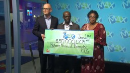 Brampton couple who lost Lotto Max ticket collect $50M cheque