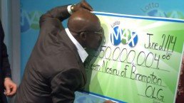 Brampton couple collects $50M Lotto Max lost ticket returned to them