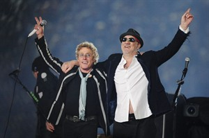 "FILE - In this Feb. 7, 2010 file photo,Roger Daltrey, left, and Pete Townshend acknowledge the crowd after performing during the second half of the NFL Super Bowl XLIV football game in Miami. Townshend and Daltrey are taking the band on the road for a series of shows in the U.K. celebrating its 50th anniversary. Daltrey suggested it would be their last major tour, referring it to the start of their ""long goodbye"" during a news conference Monday, June 30, 2014, at Ronnie Scott's jazz bar in London. (AP Photo/Mark J. Terrill, file)"