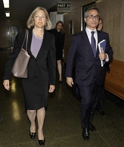 BNP Paribas general counsel Georges Dirani, accompanied by attorney Karen Patton Seymour, leaves New York state Supreme Court, in New York, Monday, June 30, 2014. France's largest bank, BNP Paribas, pleaded guilty Monday and agreed to pay nearly $9 billion to resolve criminal allegations that it processed transactions for clients in Sudan and other blacklisted countries in violation of U.S. trade sanctions. (AP Photo/Richard Drew)