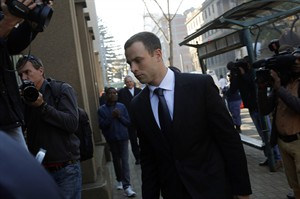 Oscar Pistorius arrives at court in Pretoria, South Africa, Tuesday, July 1, 2014. The murder trial resumed Monday June 30 after one month during which mental health experts evaluated the athlete and determined he did not have an anxiety disorder that could have influenced his actions on the night he killed his girlfriend Reeva Steenkamp. (AP Photo/Jerome Delay)