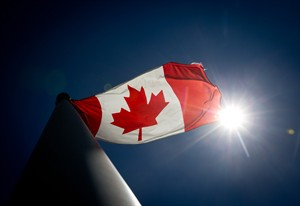 A Canadian flag flies in the wind at Granville Island in Vancouver, B.C., on Monday June 30, 2014. Canadians will mark the country's 147th birthday on Canada Day, Tuesday. THE CANADIAN PRESS/Darryl Dyck