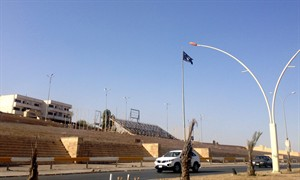 A black flag used by the al-Qaida inspired Islamic State of Iraq and the Levant (ISIL) waves over the celebrations square in the northern city of Mosul, Iraq, Tuesday, July 1, 2014. The militant extremist group's unilateral declaration of an Islamic state is threatening to undermine its already-tenuous alliance with other Sunnis who helped it overrun much of northern and western Iraq. (AP Photo)