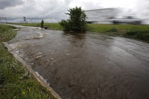 Ditches and culverts are at capacity due to overland flooding in Brandon and surrounding southwest Manitoba, Monday, June 30, 2014. Southwest Manitoba has seen a large amount of rainfall the past several days. THE CANADIAN PRESS/John Woods