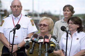 Lac Megantic mayor Colette Roy-Laroche speaks at a news conference in Lac-Megantic, Que., Saturday, July 13, 2013. Mayor Laroche put on a brave face for the world as she took charge after a deadly railway disaster struck her town, killing 47 people. Few knew she was mourning her own relatives, who were among the dead. THE CANADIAN PRESS/Jacques Boissinot