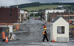 The main street of Lac-Megantic remains closed Friday, July 4, 2014. Residents prepare for the first year anniversary when an oil-filled train screeched off the tracks and exploded killing 47 people and destroying part of the downtown core. THE CANADIAN PRESS/Paul Chiasson