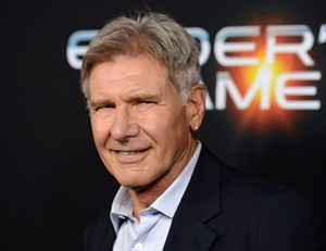 """FILE - This Oct. 28, 2013 file photo shows actor Harrison Ford at the LA Premiere of """"Ender's Game"""" in Los Angeles. Disney announced Sunday, July 6, 2014, that shooting will be halted for two weeks in August to adjust the production schedule following Ford's injury. The 71-year-old broke his leg in June during filming of the much-anticipated sequel at Pinewood Studios outside of London. (Photo by Jordan Strauss/Invision/AP, File)"""