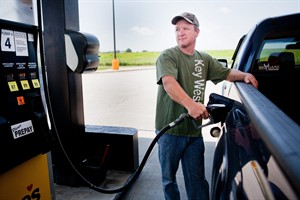 FILE - In this July 1, 2014 file photo, Lance Thompson pumps gas into his truck at a Love's station in St. Joseph, Mo. The price of oil fell for the ninth straight day Wednesday, July 9, 2014, despite continued turmoil in the Middle East, a drop that could lead to lower gasoline prices for U.S. drivers in the weeks ahead. (AP Photo/St. Joseph News-Press, Sait Serkan Gurbuz, File)