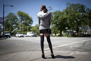 A sex trade worker is pictured in downtown Vancouver, B.C., Wednesday, June, 3, 2014. One of the architects of Sweden's anti-prostitution strategy - a model the Conservatives are trying to emulate - says the government's proposed new law is likely unconstitutional. THE CANADIAN PRESS/Jonathan Hayward