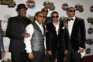 FILE - This Thursday, Nov. 8, 2012 file photo shows singers, from left, Bobby Brown, Michael Bivens, Ralph Tresvant, Ricky Bell and Ronnie Devoe of the R&B group New Edition arriving at the Soul Train Awards at Planet Hollywood Resort and Casino in Las Vegas. Brown is leaving a reunion tour with the group New Edition to focus on his health. A spokeswoman for the R&B group said on Friday, July 11, 2014 that group members Bell, Bivins, DeVoe, Johnny Gill and Tresvant wished the 45-year-old singer a speedy recovery. (Photo by Jeff Bottari/Invision/AP, file)
