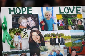 A photo collage of the Liknes and O'Brien family is displayed in Calgary, July 10, 2014.THE CANADIAN PRESS/Jeff McIntosh