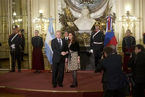 Russian President Vladimir Putin, left, and Argentina's President Cristina Fernandez pose for a photo at Government Palace during Putin's one-day visit, in Buenos Aires, Argentina, Saturday, July 12, 2014. Putin's next stop is Brazil for a presidential summit of the BRICS group of nations in Fortaleza. He was also to attend the final World Cup match in a ceremonial handover of host duties for soccer's marquee tournament, which takes place in Russia in 2018. (AP Photo/Eduardo Di Baia)