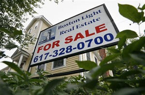 This July 10, 2014 photo shows a home for sale in Quincy, Mass. Freddie Mac reports on average U.S. mortgage rates for this week on Thursday, July 17, 2014. (AP Photo/Michael Dwyer)