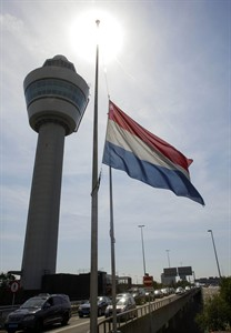 A flag flies at half-mast near the traffic tower at Schiphol airport in Amsterdam on July 18, 2014. The attack on a Malaysian jetliner Thursday afternoon killed 298 people from nearly a dozen nations, more than half being Dutch, including vacationers, students and a large contingent of scientists heading to an AIDS conference in Australia.THE ASSOCIATED PRESS/Phil Nijhuis