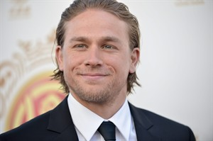 """FILE - In this June 1, 2014 file photo, Charlie Hunnam arrives at the Huading Film Awards in Los Angeles. The first trailer for the """"Fifty Shades of Grey"""" movie will be out this week and Hunnam, the original Christian Grey, says he can't wait to see the finished product. (Photo by Richard Shotwell/Invision/AP)"""