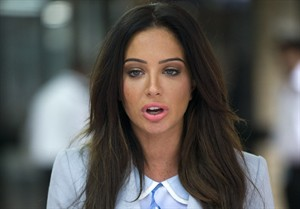 """British singer Tulisa Contostavlos delivers a statement after her trial over drugs allegations collapsed, outside Southwark Crown Court, London, Monday, July 21, 2014. The drug trial of Contostavlos collapsed after the judge said an undercover reporter known as the """"Fake Sheikh"""" probably lied under oath. The Rupert Murdoch-owned Sun on Sunday tabloid reported last year that it had caught singer and TV talent-show judge Tulisa Contostavlos acting as a go-between in a deal to sell cocaine to a reporter posing as a wealthy film producer. (AP Photo/PA, Justin Tallis) UNITED KINGDOM OUT, NO SALES, NO ARCHIVE"""