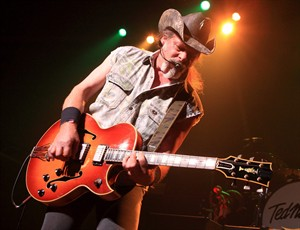 "FILE - This Aug. 16, 2013 file photo shows Ted Nugent performing at Rams Head Live in Baltimore. A Native American tribe has canceled an Aug. 4, 2014, concert by Nugent at its casino. The Coeur d'Alene Tribe on Monday, July 21, 2014, said that the cancellation of the concert at the casino in Worley was because of what it called the rocker's ""racist and hate-filled remarks.'' (Photo by Owen Sweeney/Invision/AP, File)"