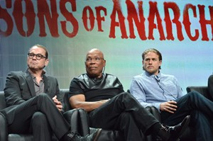 "From left, Creator Kurt Sutter, Director Paris Barclay and actor Charlie Hunnam speak on stage during the ""Sons of Anarchy"" panel at the The FX 2014 Summer TCA held at the Beverly Hilton Hotel on Monday, July 21, 2014, in Beverly Hills, Calif. (Photo by Richard Shotwell/Invision/AP)"
