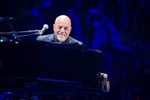 """FILE - In this May 9, 2014 file photo, Billy Joel performs at Madison Square Garden in New York. The Library of Congress on Tuesday, July 22, 2014 said Joel, whose hits include """"Piano Man"""" and """"Uptown Girl,"""" will receive its Gershwin Prize for Popular Song. (Photo by Scott Roth/Invision/AP, File)"""