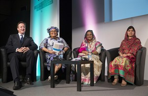 From left to right, British Prime Minister David Cameron, Chantal Compaore the First Lady of Burkina Faso, Sheikh Hasina, the Prime Minister of Bangladesh and activist Malala Yousafzai, sit, during the Girl Summit 2014 at the Walworth Academy, in London, Tuesday, July 22, 2014. Girls' rights campaigners including Malala Yousafzai are calling for an end to the practice of female genital mutilation. (AP Photo, PA, Oli Scarff) UNITED KINGDOM OUT NO SALES NO ARCHIVE