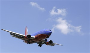 In this June 4, 2014 photo, a Southwest Airlines Boeing 737 comes in for a landing at Love Field in Dallas. The Federal Aviation Administration on Monday, July 28, 2014 is proposing a $12 million civil fine against Southwest Airlines for failing to comply in three separate cases with safety regulations related to repairs on Boeing 737 jetliners. (AP Photo/LM Otero)