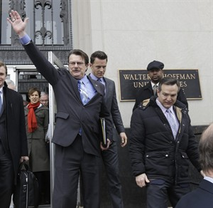 FILE- In this Feb. 4, 2014 file photo, plaintiff in the Bostic v. Rainey case, Tony London, waves to the crowd as he and his partner, Tim Bostic, right, leave Federal Court after a hearing on Virginia's ban on gay marriage in Norfolk, Va. Virginia's same-sex marriage ban is unconstitutional, a federal appeals court ruled Monday, July 28, 2014 in a decision that could overturn similar prohibitions in the Carolinas and West Virginia. (AP Photo/Steve Helber, File)