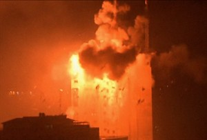In this image taken from video an explosion hits the media complex that houses the offices of Hamas-run Al Aqsa television and radio in central Gaza City early on Tuesday, July 29, 2014. The building also houses offices of a number of Arab satellite television news channels. (AP Photo/APTN)