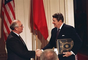 "FILE - Int this Dec. 8, 1987, file photo, U.S. President Ronald Reagan, right, shakes hands with Soviet leader Mikhail Gorbachev after the two leaders signed the Intermediate Range Nuclear Forces Treaty to eliminate intermediate-range missiles during a ceremony in the White House East Room in Washington. In an escalation of tensions, the Obama administration accused Russia on July 28, 2014, of conducting tests in violation of a 1987 nuclear missile treaty, calling the breach ""a very serious matter"" and going public with allegations that have simmered for some time. The treaty confrontation comes at a highly strained time between President Barack Obama and Russian President Vladimir Putin over Russia's intervention in Ukraine and Russia's grant of asylum to National Security Agency leaker Edward Snowden.(AP Photo/Bob Daugherty, File)"