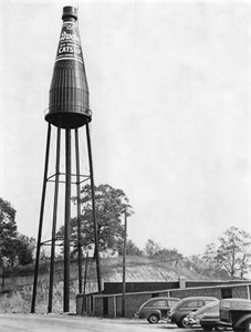 This 1950s photo provided by Michael Gassmann shows the iconic giant ketchup bottle water tower outside the old Brooks bottling plant in Collinsville, Ill. The Collinsville water tower is a depiction of Brooks Old Original Rich and Tangy Catsup, which was once produced in the buildings beneath the tower. Now, the sign is for sale. Owner Larry Eckert is asking $500,000 for the 65-year-old, 170-foot (52-meter)-tall landmark and adjacent warehouse. (AP Photo/Courtesy Michael Gassmann)