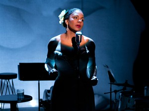 """This photo provided by Jeffrey Richards Associates shows Audra McDonald as Billie Holiday in """"Lady Day at Emerson's Bar & Grill"""". McDonald has propelled her new Broadway show into profitability. Producers of the play """"Lady Day at Emerson's Bar & Grill"""" said Tuesday that they've recouped their $2.6 million initial investment. In the show, McDonald portrays Billie Holiday in one of her last concerts, offering stories and performing about a dozen of Holiday's best known songs, including """"God Bless the Child,"""" """"What a Little Moonlight Can Do,"""" and """"Strange Fruit."""" (AP Photo/Jeffrey Richards Associates, Evgenia Eliseeva)"""