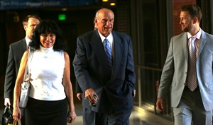 """FILE - In this July 22, 2014 file photo former Minnesota Gov. Jesse Ventura, center, arrives at court with his wife, Terry, and others for his defamation lawsuit against """"American Sniper"""" author Chris Kyle in St. Paul, Minn. Kyle wrote in his best-seller that he decked Ventura in a California bar in 2006 after Ventura allegedly said Navy SEALs """"deserve to lose a few."""" Ventura, a former SEAL and pro wrestler, testified Kyle fabricated the story. Kyle denied that in testimony videotaped before his death last year. (AP Photo/The Star Tribune, Jim Gehrz, File) MANDATORY CREDIT; ST. PAUL PIONEER PRESS OUT; MAGS OUT; TWIN CITIES LOCAL TELEVISION OUT"""