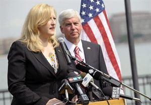Lisa Raitt, Canada's Minister of Transportation, left, and Michigan Gov. Rick Synder answer questions from reporters during a news conference regarding the planned new $2 billion bridge linking Detroit and Windsor, Ontario, Wednesday, July 30, 2014 in Windsor. Michigan and Canada have appointed members of an authority to oversee construction of the bridge. (AP Photo/Detroit News, Clarence Tabb Jr.) DETROIT FREE PRESS OUT; HUFFINGTON POST OUT