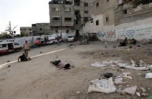 Palestinians lay on the ground following an Israeli Strike in Shijaiyah neighborhood, eastern Gaza City, Wednesday, July 30, 2014. (AP Photo/Adel Hana)