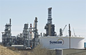 The Suncor Refinery in Edmonton is seen on Tuesday, April 29, 2014. Suncor Energy Inc. has posted a nearly 70 per cent drop in net income during the second quarter as it took charges related to the cancellation of the Joslyn oilsands project and unrest in Libya. THE CANADIAN PRESS/Jason Franson