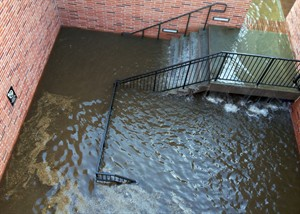 Water has filled the stairs to a parking structure adjacent to the main entry doors of Pauley Pavilion, home of UCLA basketball, after a 30-inch water main burst on nearby Sunset Boulevard Tuesday, July 29, 2014, in Los Angeles. Water also reached the playing floor of the basketball arena. (AP Photo/Matt Hamilton)