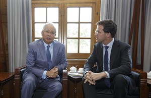 Malaysian Prime Minister Najib Razak, left, and Dutch Prime Minister Mark Rutte, right, pause, prior to their talks in The Hague, Netherlands, Thursday, July 31, 2014. Razak is making his first official visit to the Netherlands in the wake of the Malaysia Airlines Flight 17 disaster, in which an ill-fated passenger jet bound from Amsterdam to Kuala Lumpur was shot down in eastern Ukraine. Razak and Rutte are expected to discuss plans for the repatriation of the remains of the 43 Malaysian victims. (AP Photo/Phil Nijhuis, Pool)