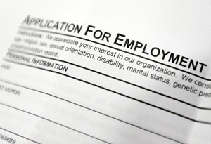 An employment application form is pictured at a job fair in Hudson, N.Y. on April 22, 2014. THE CANADIAN PRESS/AP, Mike Groll