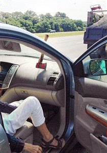 """In a photo provided by Massachusetts State Police, an ax head rests on the dashboard with the handle stuck in the windshield of a motorist's car after falling off a landscaper's truck on Route 95 in Topsfield, Mass., Wednesday July 30, 2014. Police said the car's passenger was """"shaken up"""" but not hurt. The truck driver, from Peabody, Mass., was cited for failing to secure the ax, which carries a $200 fine. (AP Photo/Massachusetts State Police)"""