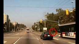 Dashcam captures TTC bus running red; nearly striking pedestrian