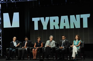 "From left, Howard Gordon, showrunner/executive producer, Salam Al-Marayati, Ambassador Cynthia P. Schneider, Michael Wolfe, Ramy Yaacoub and Aseel Albanna speak on stage during the ""Tyrant"" panel at the The FX 2014 Summer TCA held at the Beverly Hilton Hotel on Monday, July 21, 2014, in Beverly Hills, Calif. (Photo by Richard Shotwell/Invision/AP)"