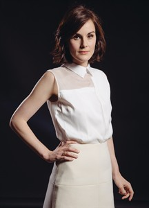"""Michelle Dockery of the PBS Masterpiece TV series, """"Downton Abbey,"""" poses for a portrait during press day at The Beverly Hilton on Tuesday, July 22, 2014, in Beverly Hills, Calif. Season five of the period drama debuts this fall in the United Kingdom, and this winter stateside. (Photo by Casey Curry/Invision/AP)"""