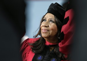 FILE - In a Thursday, May 29, 2014 file photo, singer Aretha Franklin looks up while seated on stage during Harvard University commencement ceremonies, in Cambridge, Mass. Franklin, the Queen of Soul says she's looking forward to tracking down one of the powdered sugar-covered confections while she's at the Ohio State Fair to perform on Thursday, July 31, 2014. (AP Photo/Steven Senne, File)