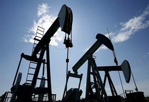 Pumpjacks at work pumping crude oil near Halkirk, Alta., June 20, 2007. THE CANADIAN PRESS/Larry MacDougal