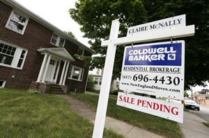 A sale pending sign is posted in front of a home for sale in Quincy, Mass. on July 10, 2014. THE CANADIAN PRESS/AP, Michael Dwyer