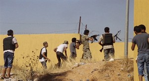 Fighters from the Islamist Misarata brigade fire towards Tripoli airport in an attempt to wrest control from a powerful rival militia, in Tripoli, Libya on July 26, 2014. THE CANADIAN PRESS/AP, AP video
