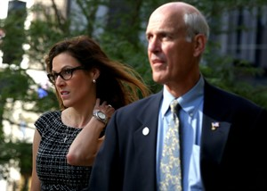 "FILE - In this July 22, 2014, file photo, Taya Kyle, left, widow of Navy Seal and author Chris Kyle, arrives at court in St. Paul, Minn. Jurors in former Minnesota Gov. Jesse Ventura's defamation lawsuit against ""American Sniper"" author Chris Kyle have gone home for the night Monday, July 28, 2014, but will return Tuesday. (AP Photo/The Star Tribune, Jim Gehrz, File) MANDATORY CREDIT; ST. PAUL PIONEER PRESS OUT; MAGAZINES OUT; TWIN CITIES LOCAL TELEVISION OUT"