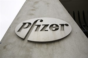 This May 4, 2014 photo shows the Pfizer logo on the exterior of a former Pfizer factory, in the Brooklyn borough of New York. The pharmaceutical giant reports quarterly financial results on Tuesday, July 29, 2014. (AP Photo/Mark Lennihan)